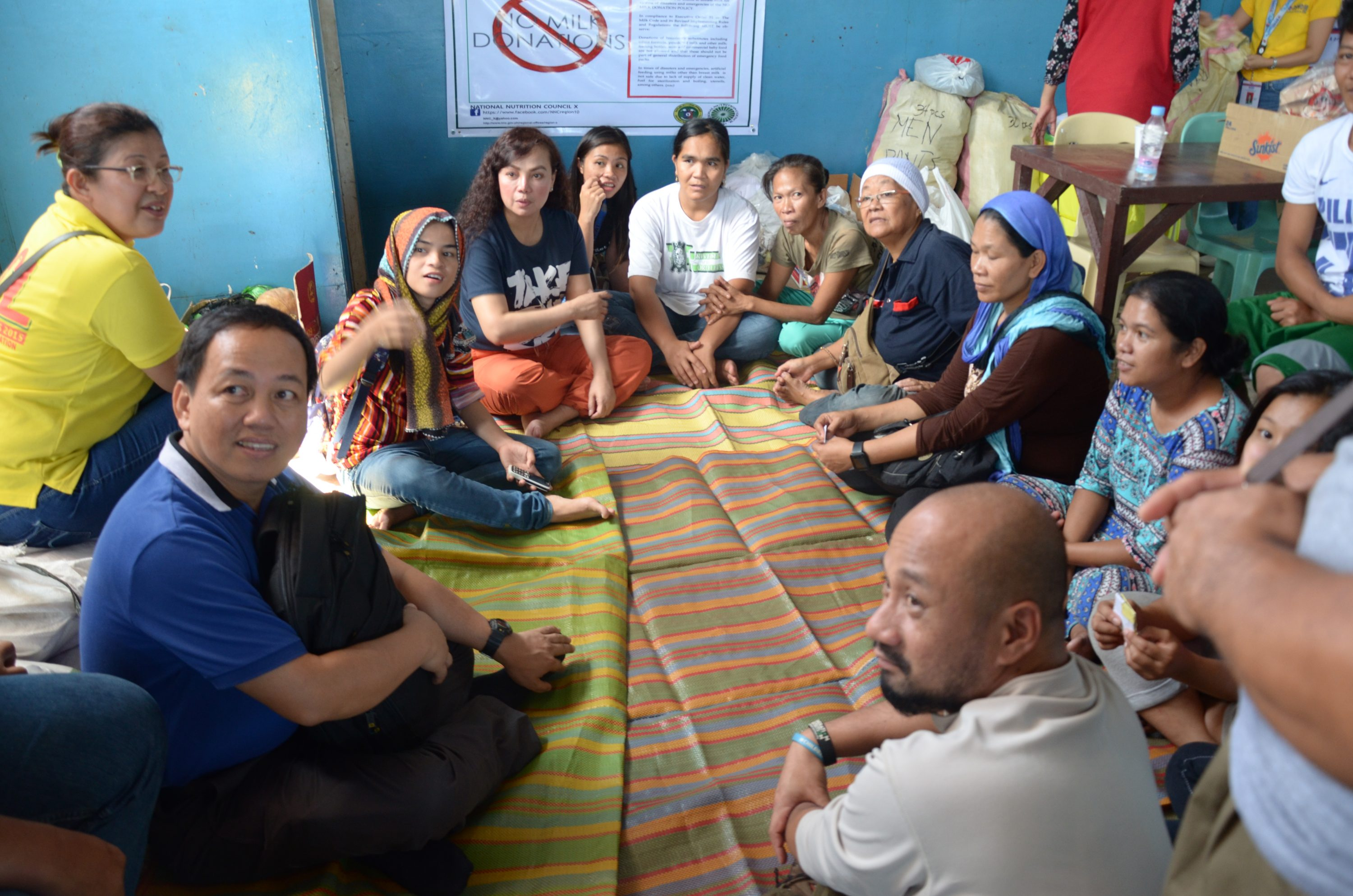 The Leaders At Ma. Cristina Evacuation Center In Iligan Talking With The Team.