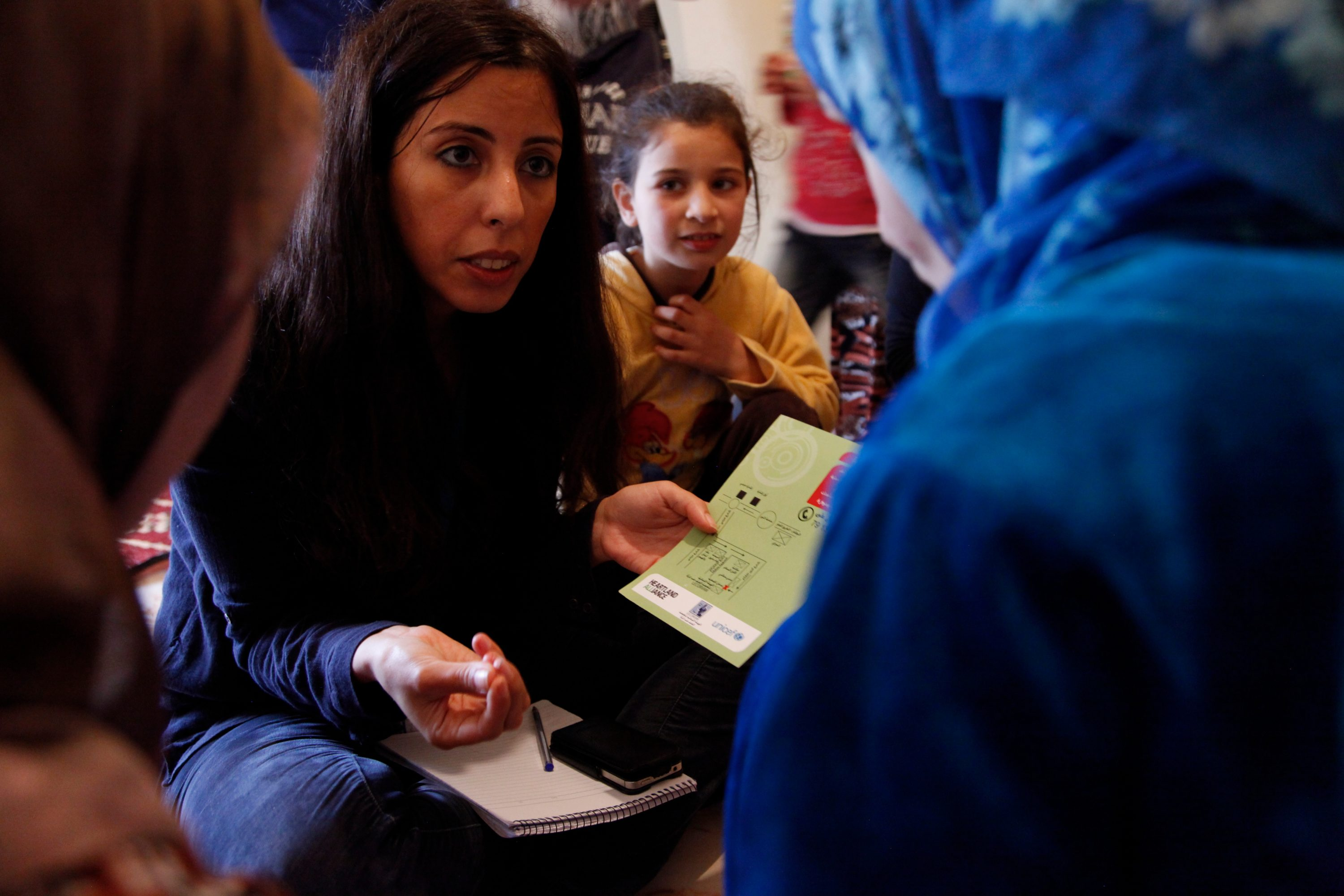Syrian Refugee Women And Their Children Attend A Mobile Gender-based Violence Outreach Session In An Unfinished Apartment Block In Nothern Lebanon. The Apartment Complex Is Being Rented By Syrian Refugee Families, Many Of Whom Are Living Two Or Three Families In Each Apartment. The Outreach Sessions Are Run The By NGO Heartland Alliance And Local NGO Lecorvaw, With Support From UNICEF And UK Aid.