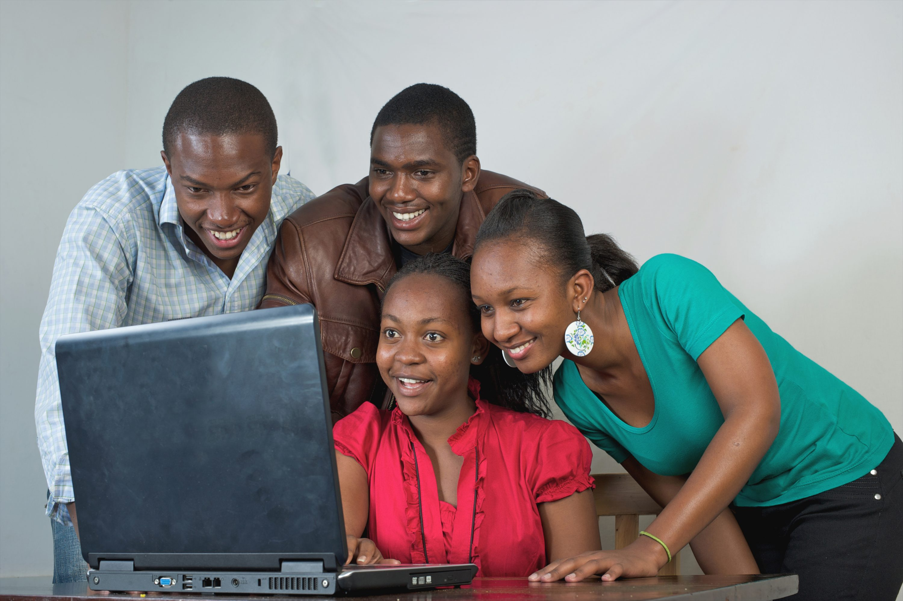 Kenyan Students Gathered Around Laptop, Nairobi, Kenya