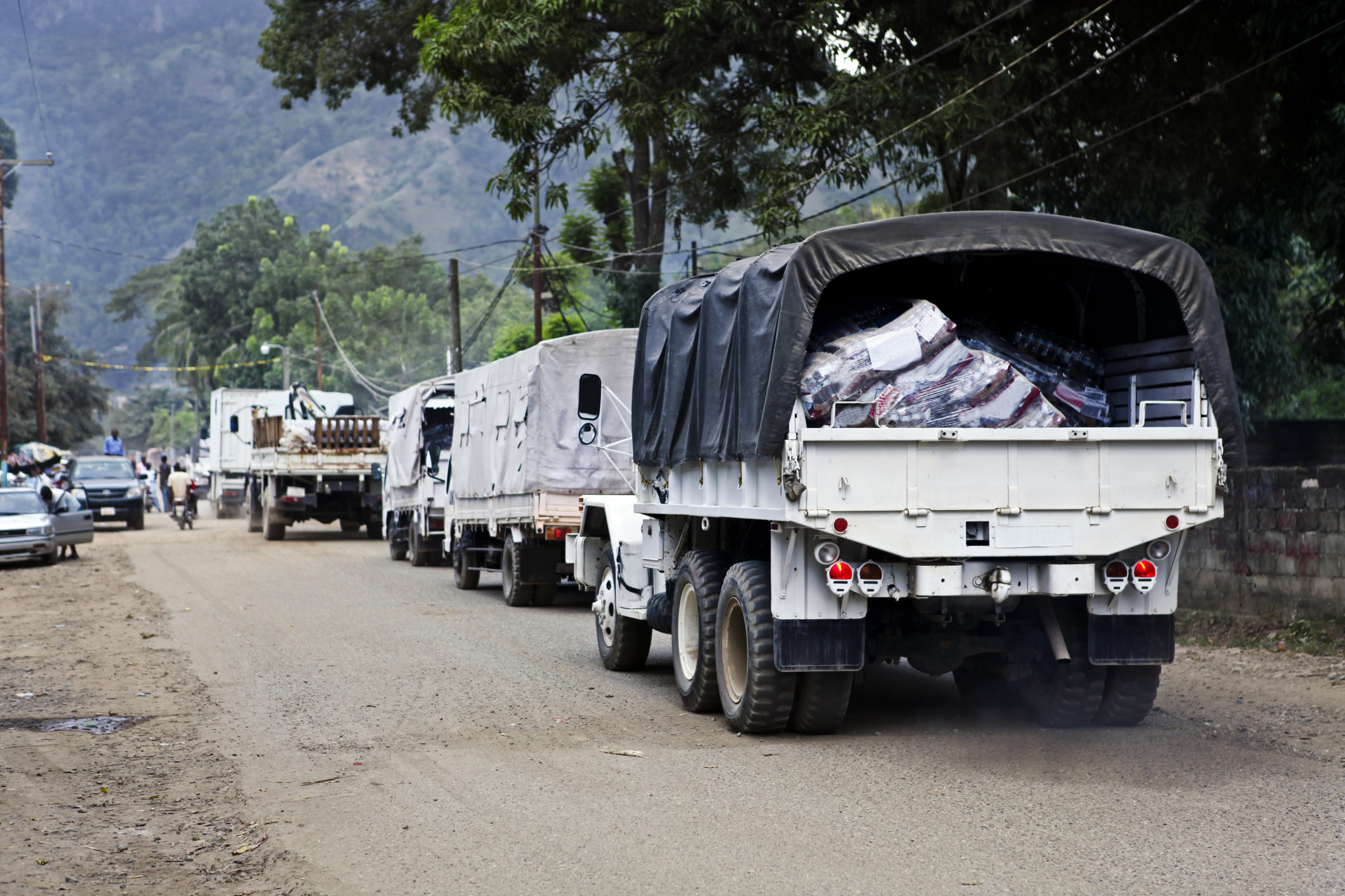 Trucks On The Way Of Haiti For Helping People After Earthqauke